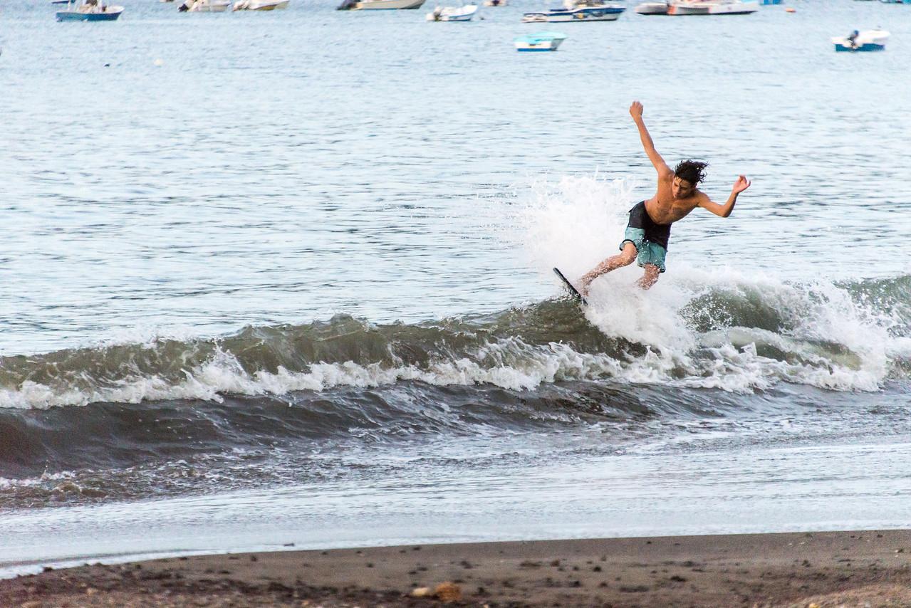 Surfing along the shoreline in Playas Del Coco, Costa Rica - December 2014