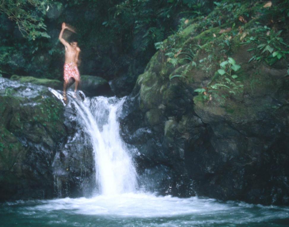 River Guide taking a dip near El Rio Pacquare Costa Rica