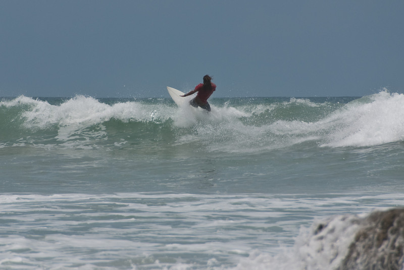 Surfing off the beach near Hotel Tropico Latino.