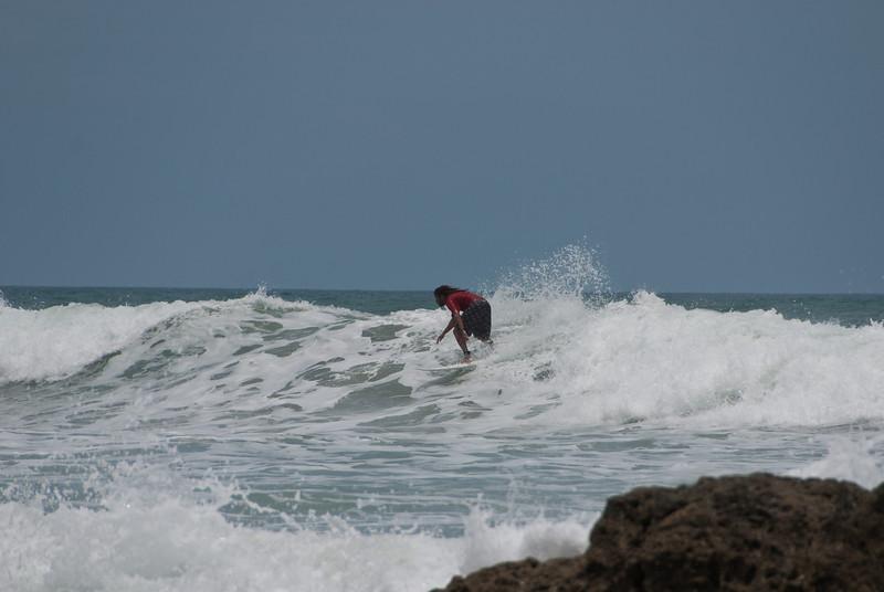 Surfing off the beach near Hotel Tropico Latino.