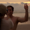 Ann and David filming a sunset lit, post-surfing, video.
