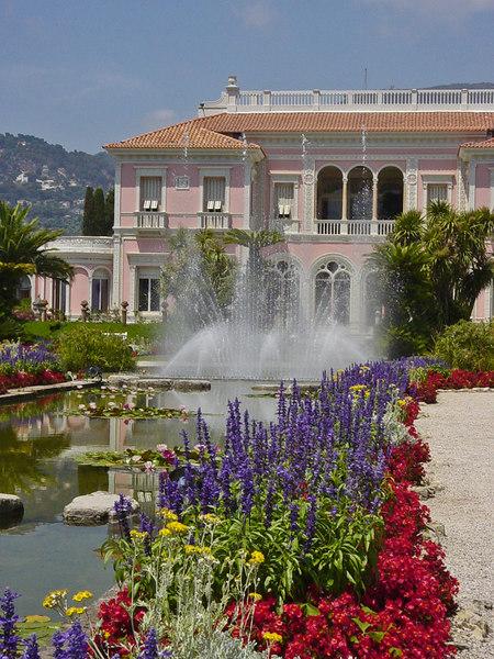 Summer blooms in garden of luxurious pink villa on St. Jean Cap Ferret - Cote D' Azur - France