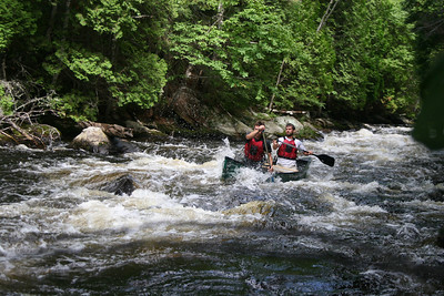 Day three, after wishing friends and families goodbye, Cliff and Doug run their first rapids. Photo: Rory Gawler.