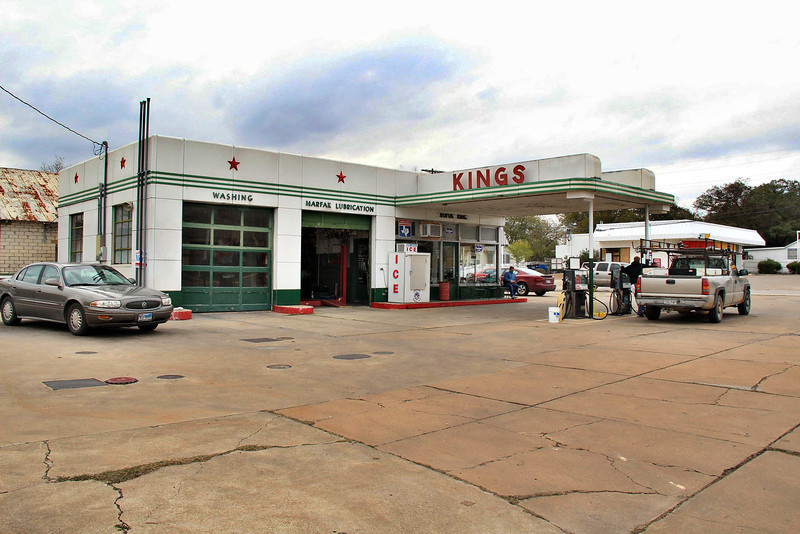 "The Kings gas station in Gonzales still provides full service for all customers. This was a Texaco station built in 1951, using the familiar ""Teague Texaco"" design, named after the designer. This style was the nationwide standard for Texaco from 1938 until 1964, and many thousands were built. Few remain because Texaco remodeled all the stations they controlled in the 1980's."