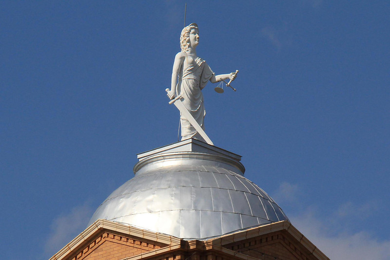 The Jones County Courthouse in Anson, Texas is topped with a brazen young lady who wields a wicked sword and a scales of justice in need of a tuneup. We trust the daily proceedings below are much more balanced.