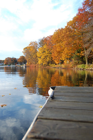Sunrise on a brilliant autumn morning over a New England lake