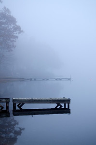 Foggy autumn morning on Lake Wangumbaug, Coventry, Connecticut.