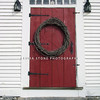 A grapevine wreath on a New England colonial home.