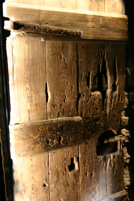 17th Century Dungeon door carved with French prisoners last words
