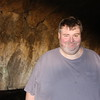 This is me in the same cave, about 200 yards deep.  It didn't smell good, and the flashlight I brought with me was a disappointment, so I was ready to go. :)