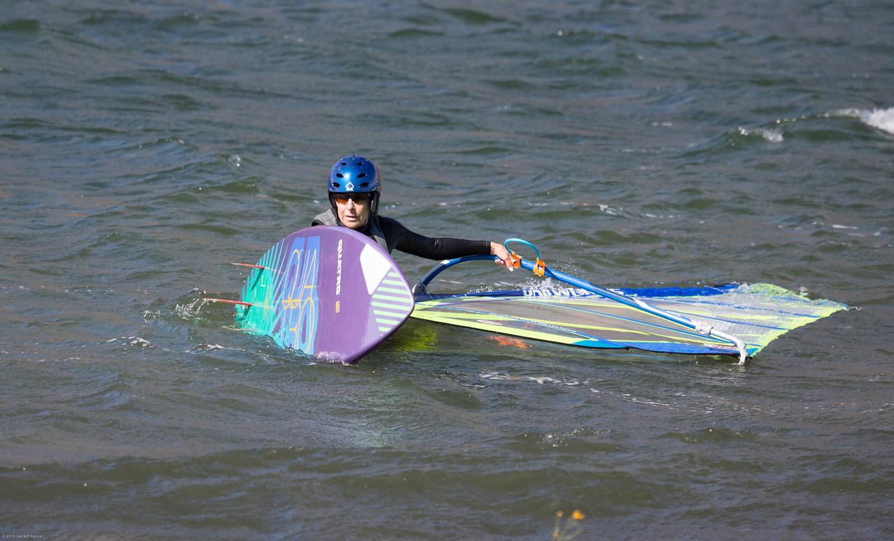 Wind Surfer Ready for a Break