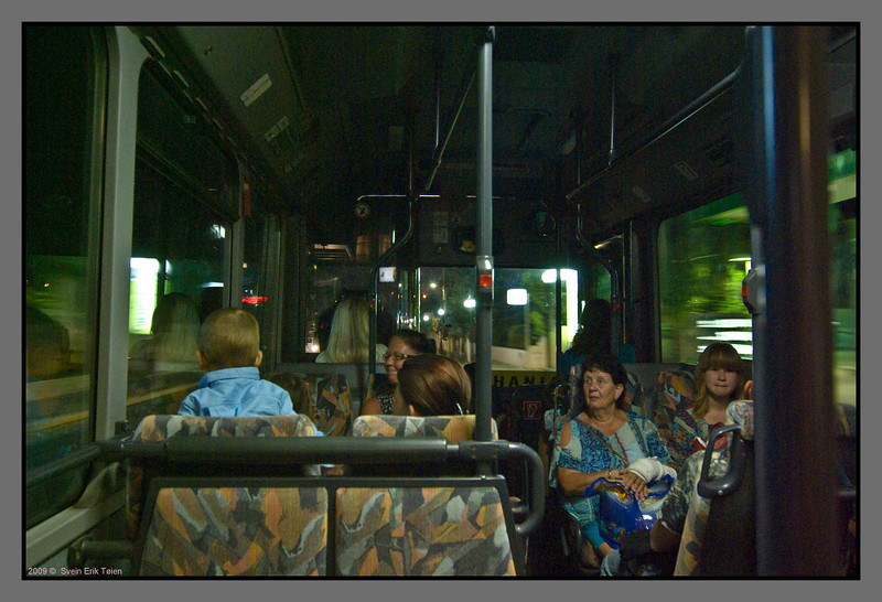 Commuting to Stalos and Platanias. Local buses are manned with driver plus ticket salesman.