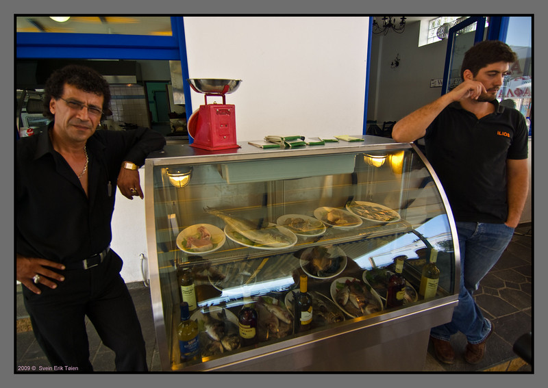 Proud keepers of restaurant, displaying fish...