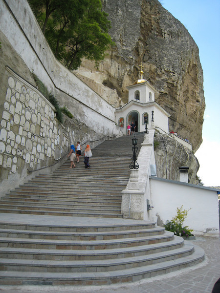 Bakchasarai, Crimea - Orthodox cliff-dweller church and monastery -- relics are built into the wall on left