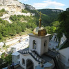 Bakchasarai, Crimea - Orthodox cliff-dweller church and monastery -- looking toward ancient Jewish settlement opposite