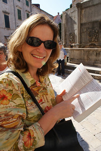 The Attache pointing in her Croatia travel book.