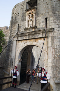 Pila Gate The Pila Gates are a well-fortified complex with multiple doors, defended by Fort Bokar and the moat that ran around the outside section of the city walls. At the entrance gate to the Old Town, on the western side of the land walls, there is a stone bridge between two Gothic arches, which were designed by the esteemed architect Paskoje Miličević in 1471. That bridge connects to another bridge, a wooden drawbridge which can be pulled up.