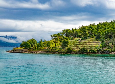 Peaceful island landscape--farm--with oncoming storm from the mainland
