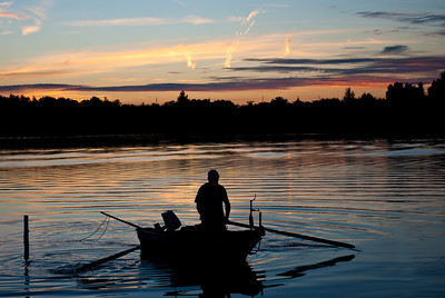 Fisherman on the boat in the sunset
