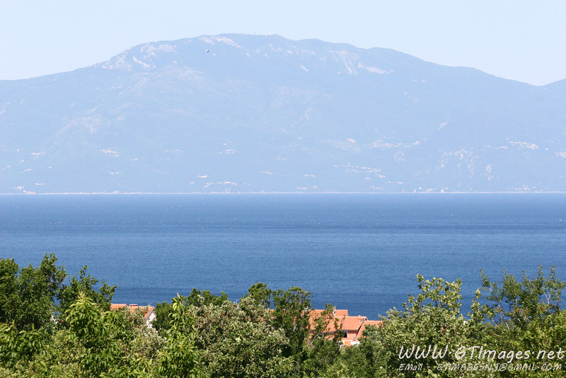"We stayed in the village of Kremenic, on the Island Krk. This is a view from the bedroom window. That is the Kvarner bay, the mountain in the background is called ""uchka"" - phonetically spelled. ""uchka"" is on the Istrian Penninsula."