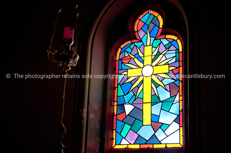 """Croatia, """"Heaven on Earth"""", leadlight window, depiction of cross and candle. SEE ALSO:  <a href=""""http://www.blurb.com/b/2340783-croatia"""">http://www.blurb.com/b/2340783-croatia</a>"""