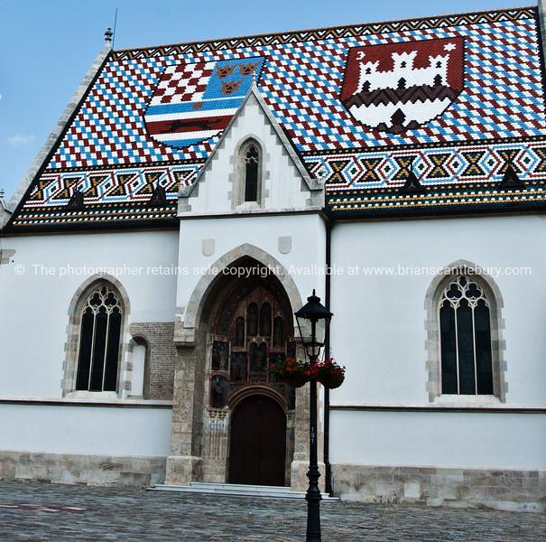 """Croatia, """"Heaven on Earth"""" St Marks Church, with iots tiled roof and coats of arms for Zagreb (white catsle) and Croatia. SEE ALSO:  <a href=""""http://www.blurb.com/b/2340783-croatia"""">http://www.blurb.com/b/2340783-croatia</a>"""