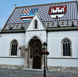 """Croatia, """"Heaven on Earth"""" St Marks Church, with iots tiled roof and coats of arms for Zagreb (white catsle) and Croatia. SEE ALSO: www.blurb.com/b/2340783-croatia"""