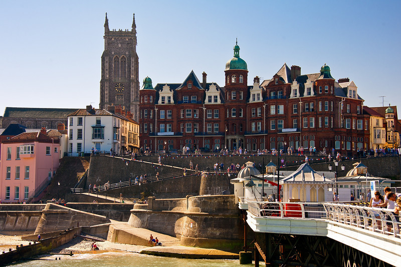 Cromer is perched on the edge of the north Norfolk Coast. Cromer became a resort town in the early 19th Century.  The views here are of The Hotel de Paris and the Tower of the Parish Churchn- St. Peter and St. Paul, which has stood in the center of Cromer for well over 600 years.