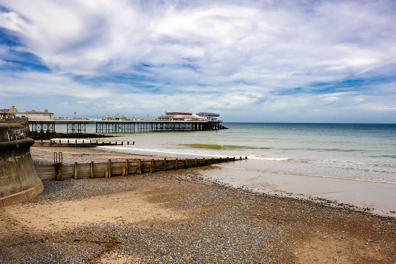 Cromer pier ( late Victorian style )  and groynes as viewed from the East side of the Beach.