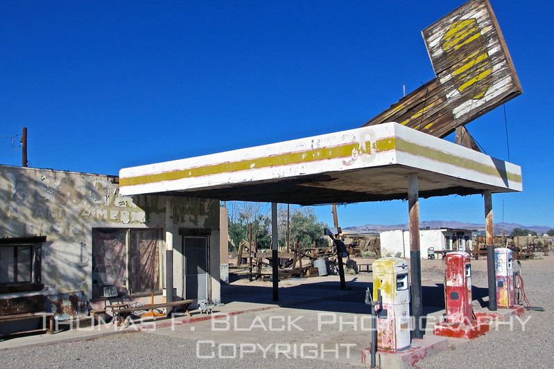 Long-abandoned filling station next to bagdad cafe. gas jockey was on break and oil tanker was not due for another hour.