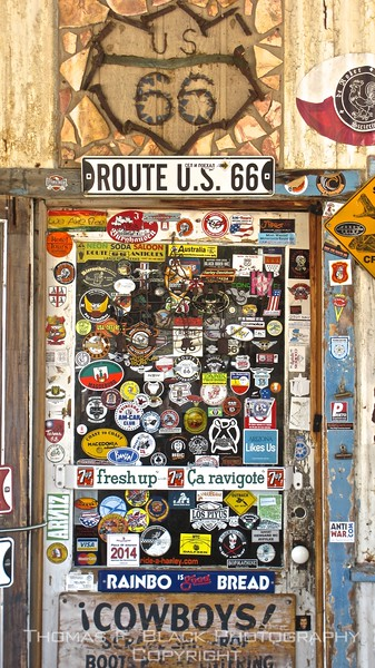 """door to what is called a """"general store"""" in one-horse town of hackberry, west of kingman, AZ. It began life in the early 1930s as a conoco station and lasted until 1978, when it was shuttered, rendering hackberry, once a thriving mining town, deserted. It repopened as a tourist trap (er, general store) in 1992. the draw for me was the bevy of old vehicles strewn about the property, several of which are captured in frames that follow. note decal reading """"arizona likes us."""" store must have facebook presence."""