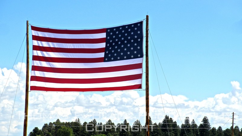 supersized old glory, stretched gloriously between telephone poles in front of san luis valley water district hq on hwy. 160.