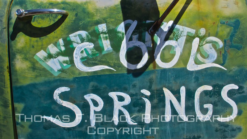 "detail of truck door panel. ""c66l"" is scribbled over word ""wright's."" Not-so cool springs must be an art colony."