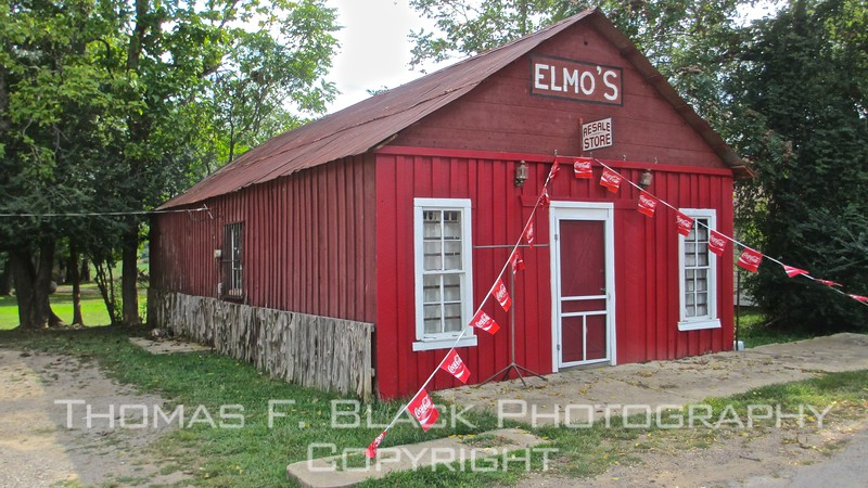 "shuttered store in oark. obvious question to be asked: ""where's elmo?"" possibly same place as waldo."