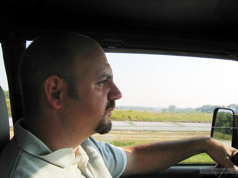 Paul driving angrily through Kansas.