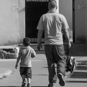 A father and son on the way home after school in Tirana