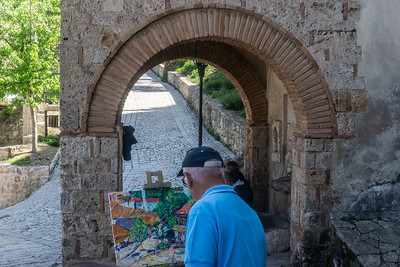 An artist at work on the castle grounds in Kruja