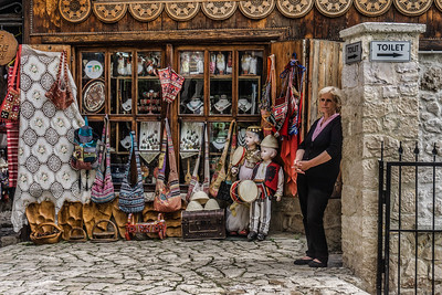 A shopkeeper during a quiet moment in Kruja