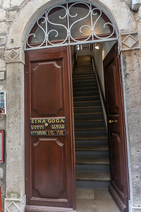 Entrance to the Old Synagogue in Dubrovnik, It is the oldest Sefardic synagogue still in use today.  It is said to have been established in 1352, but gained legal status in the city in 1408.the local  Jewish community still owns the synagogue where the main floor still functions as a place of worship for Holy days and special occasions.  It is now mainly a city museum .nturies-old artifacts.