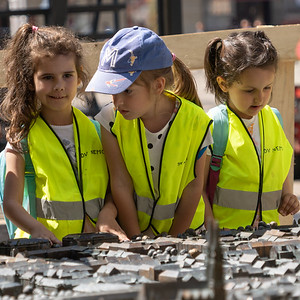 School children viewing a model of Old Town in Zagreb.