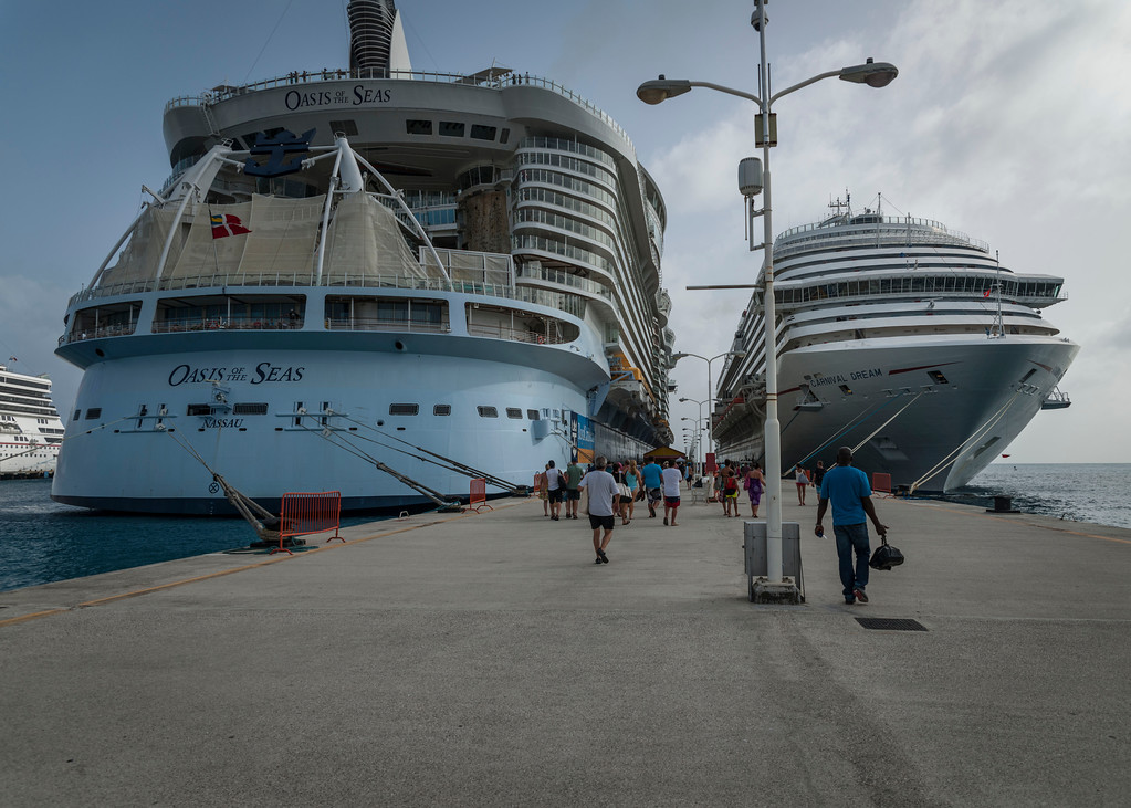 "Royal Caribbean's Oasis of the Seas and her Carnival ""dingy""! ;-)  <br /> This isn't a Cruise Ship!  It's a floating City!"