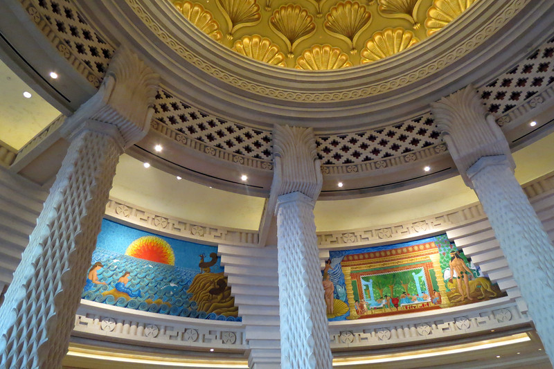 The domed ceiling displays eight murals that tell the story of Atlantis from its days of glory to its impending destruction. The murals were painted by artist Albino Gonzalez.  [B]