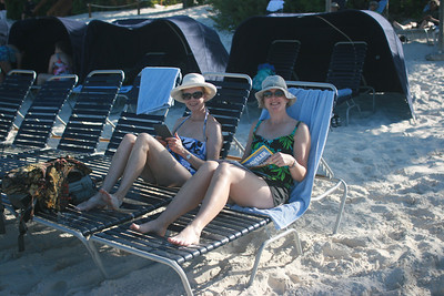 Reading on the beach at Half Moon Cay, Bahamas