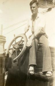 Dad at the helm. At sea, Tongan Islands.