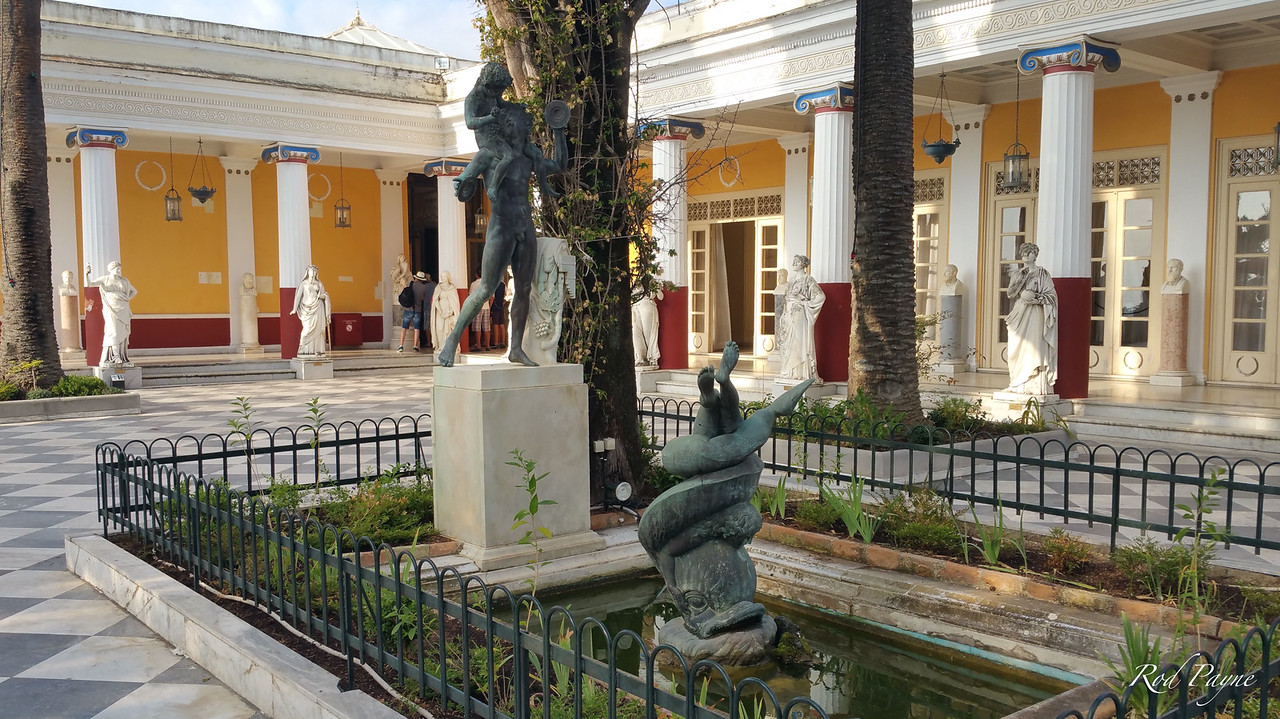Statues of 9 Muses in front of the building, and busts of famous philosophers behind the Muses, closer to the building.