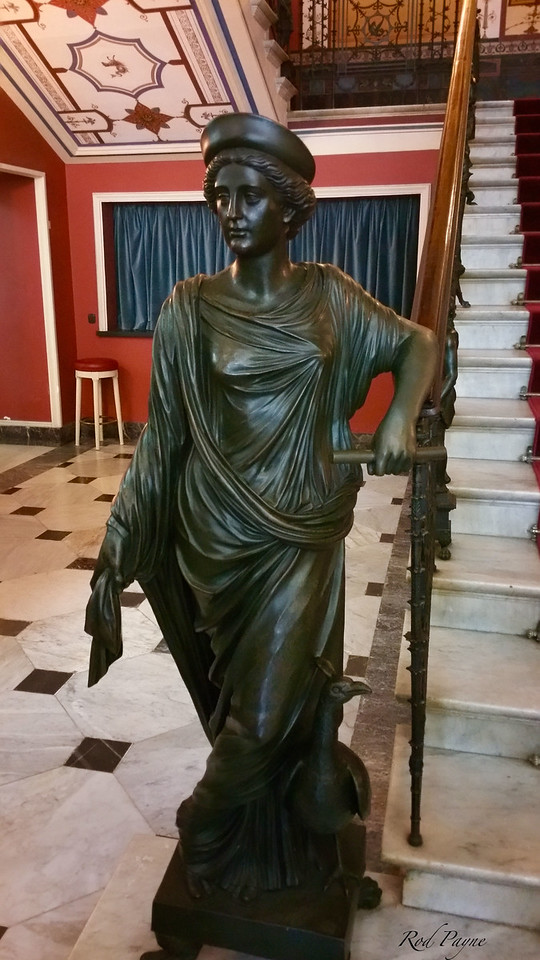 Statue of Hera to the left of the marble staircase.
