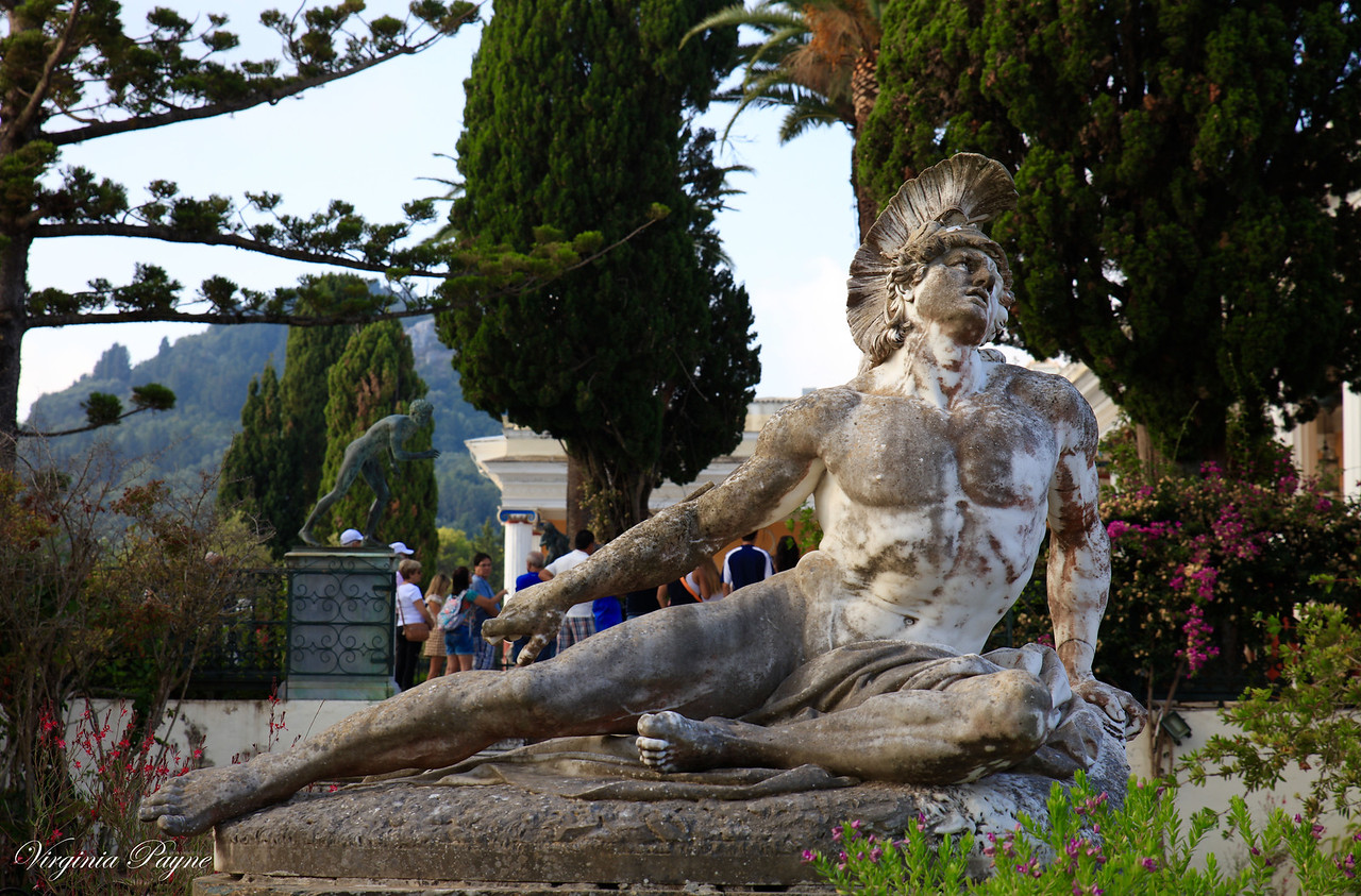 "The centrepiece of the gardens is a marble statue on a high pedestal, of ""The Wounded Achilles"" (Achilleús Thnēskōn) - by the German sculptor Ernst Herter in 1884."