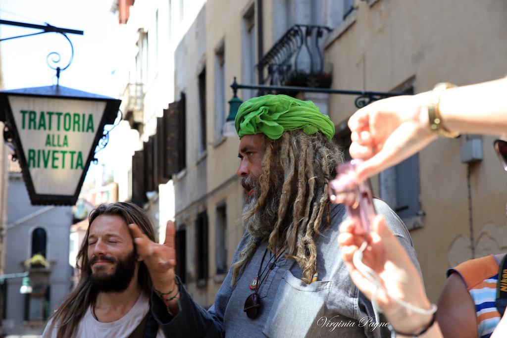The green turban matches the green restaurant sign!...