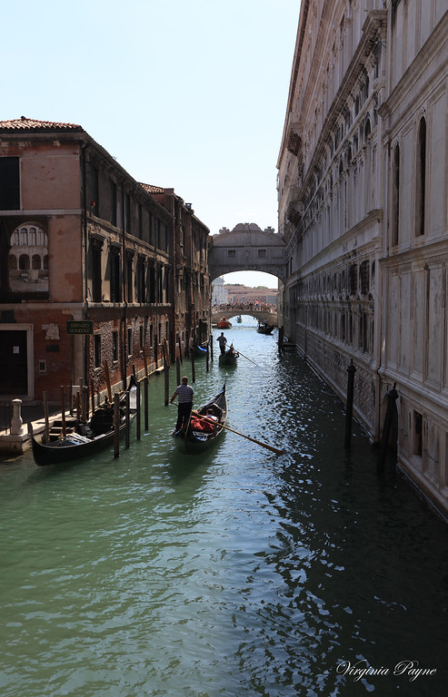 """The famous """"Bridge of Sighs"""" with the palace on the right, and the prisons on the left."""