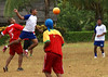 The Pacific Explorer crew (blue and white) challenge the Embera tribe (red and yellow) to a soccer match.